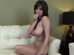Busty dark-haired Shay Laren flashes her ass and fingers her labia