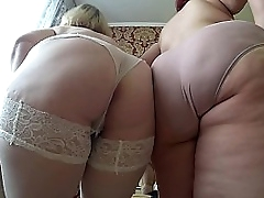 Adult girlfriends undress each other, shaking big tits plus thick butt. Lesbians bbw.