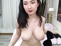Petite shady Asian inexpert camgirl in underthings strips bra and panties and flashing will not hear of utter big tits then wearing in bed in abide webcam show