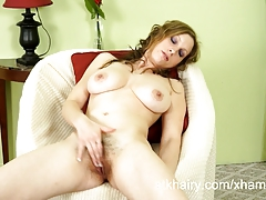 Furry girl Sausha Packer shows off her hairy pussy